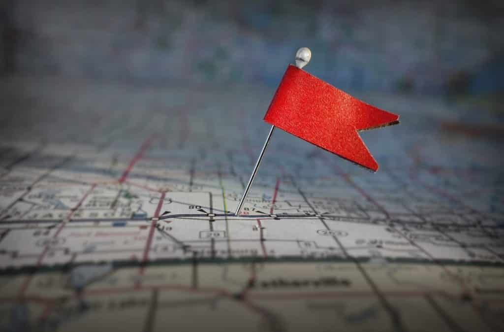 small red flag pinned to map