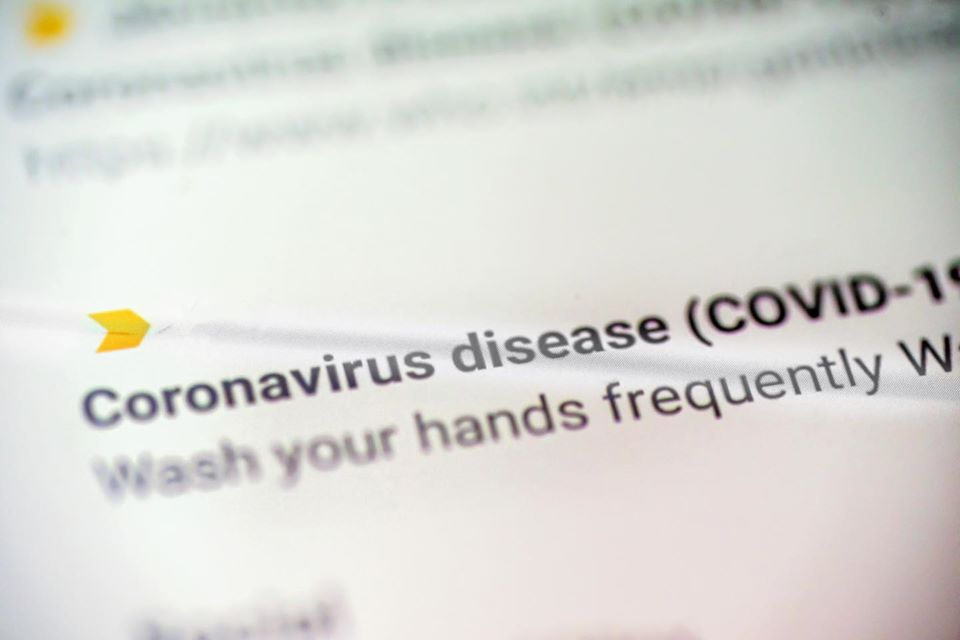 close up picture of text talking about coronavirus disease